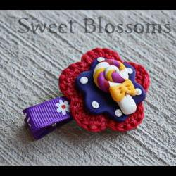 crochet flower hair clip topped up with polymer clay bead